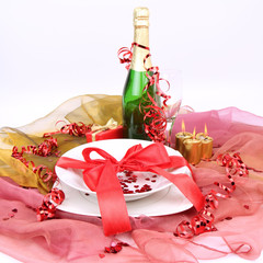 New Year's or Valentine's setting-champagne and a plate