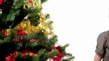 Video with cute boy near a Christmas tree