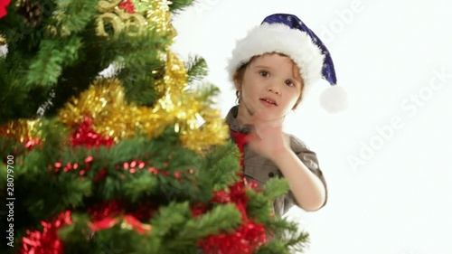 Video with cute boy near a Christmas tree