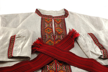 Traditional ukrainian clothes -  embroidered shirt and red sash