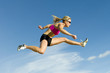Athlete Jumping Against a Sky Backdrop