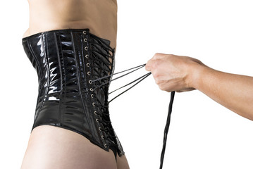 Male hands lacing back of a corset.