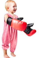 Beautiful baby in boxing gloves punching