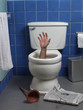 Hand reaches up through the seat from out of a toilet.
