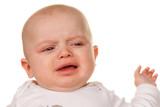 Gesicht eines weinenden, traurigen Babys