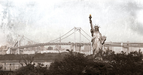 Statue of Liberty and a Rainbow bridge in Tokyo, Japan