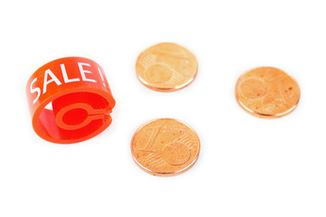 "Red hanger marker with ""Sale"" word and euro coins"