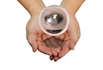Crystal Ball floating over hands.