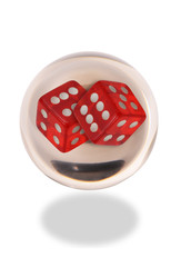 Crystal Ball with Red Dice in it.