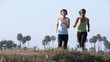 Two young women jogging outdoors