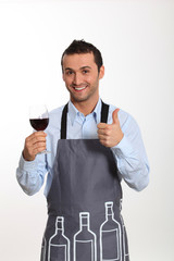 Sommelier tasting red wine