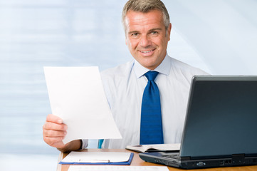 Mature businessman working in office