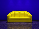Yellow couch in blue grunge interior