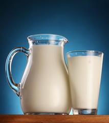 Glass and jar of milk. photo.