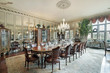 Formal dining room with wall mirrors