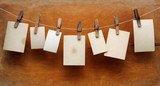 vintage photographs hang on the clothespin isolated on Wood wall
