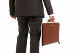 Unrecognizable businessman back with suitcase isolated on white poster