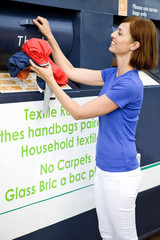A mid-adult woman recycling clothes