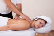 Young beautiful woman getting spine massage