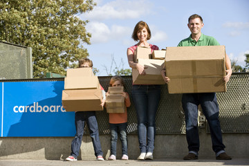 A family recycling cardboard boxes