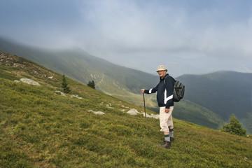 older man walking on beautiful mountain