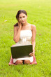 Outdoor portrait of young lady with laptop