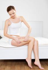 beautiful woman folding skin on her hips