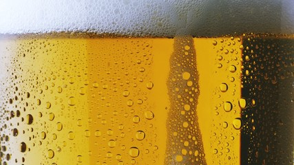 Foam sliding down side of beer glass