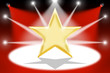 Gold star with light beams - Red background