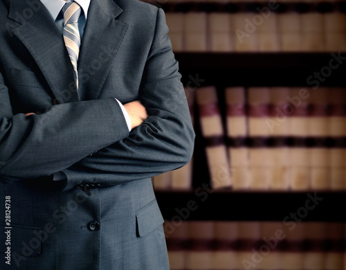 Businessman in front of books