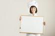Chef Holding Blackboard