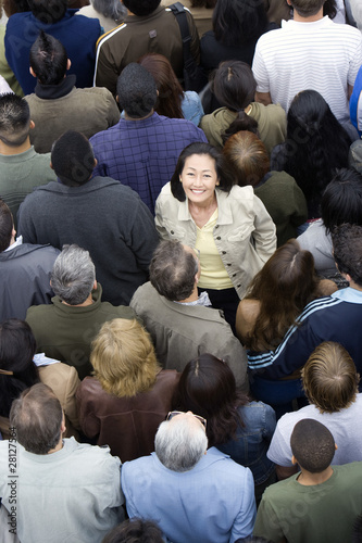 Woman standing among crowd