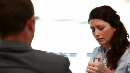 Interview between a businesswoman and a man