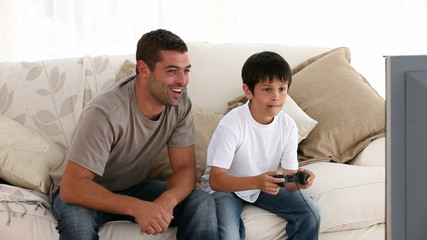 Father and his son playing together