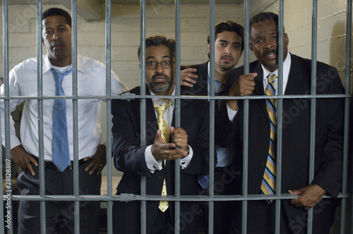 Four people in prison cell