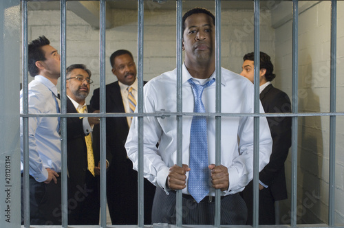 Group of men in prison cell