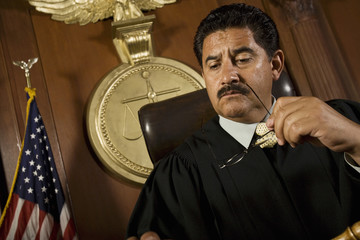 Pensive judge sitting in court