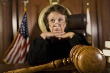 Female judge pondering over sentence