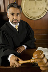 Middle-aged judge holding gavel