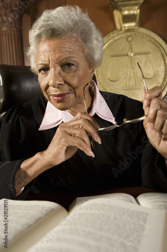 Female judge sitting in court, portrait