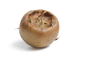 Whole fresh ripe medlar at white background