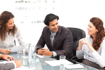 Businessman and businesswomen talking together around a table