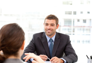 Two business people talking together during a meeting