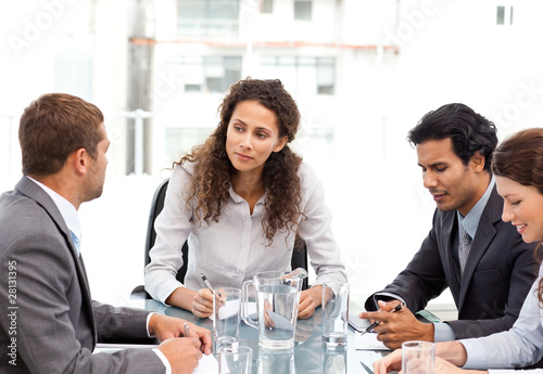 Beautiful manager speaking with her team during a meeting