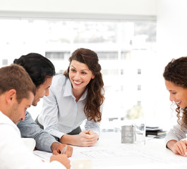 Happy female architect with her team during a meeting