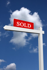 Sold sign with sky background