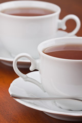 Two cups of tea with saucers