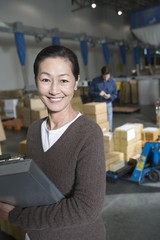Asian woman in distribution warehouse, portrait