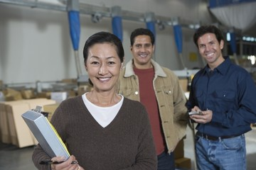 Men and woman in distribution warehouse, Portrait
