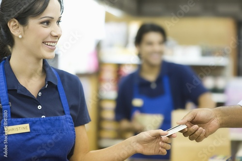 Supermarket employee in blue apron